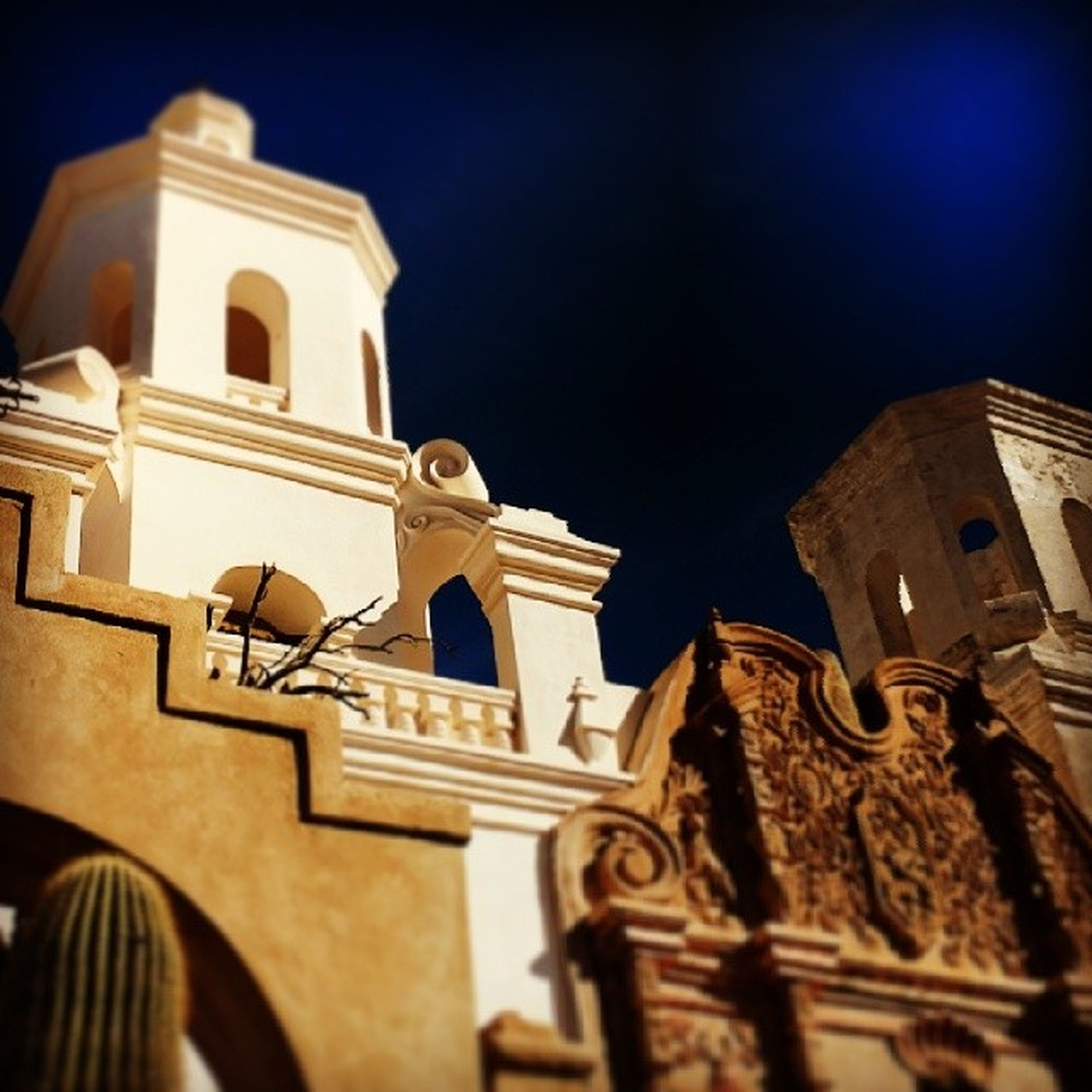 building exterior, architecture, built structure, religion, low angle view, church, place of worship, spirituality, cross, cathedral, clear sky, high section, no people, night, sky, outdoors, old, history