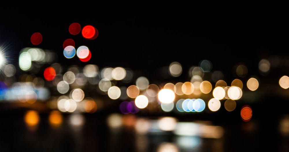Defocused lights/bokeh at night looking across london buildings from tate modern, london