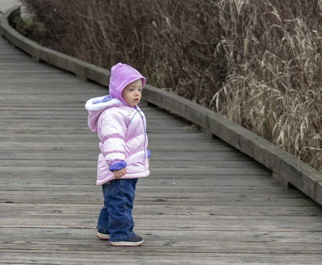 18 months old baby is enjoying the nice Winter weather. Bundled up for the cold. 1.5 years old toddler walking in parks when the sun is out Looking Real People Girls Child Day Cute Standing Outdoors Baby Childhood Innocence Clothing Young Females Footbridge Pink Color Full Length One Person Casual Clothing Leisure Activity Wood - Material Warm Clothing Hood - Clothing Winter 18 Months Old 1 Year Old Babyhood Babygirl Baby ❤ Toddler  Toddlerlife Toddler Girl Little Girl Green Eyes Children Children Only Children Photography Children's Portraits Winter Scene Autumn colors Jeans Denim Cloudy Day Cold Temperature Casual Look Blue Eyes !!!! Pink Jacket Winter Boots Jnjvisualimage Yellow Grass