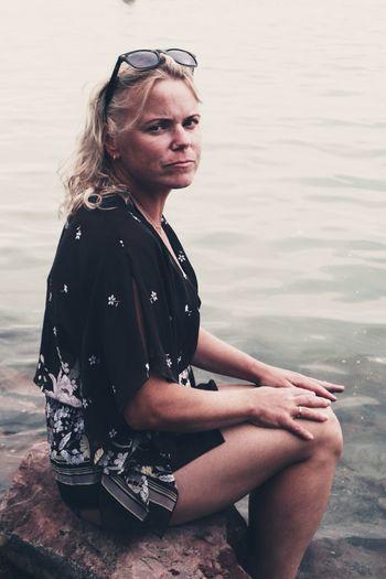 Portrait of woman sitting in lake