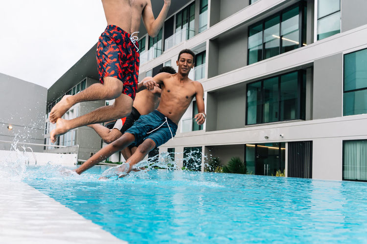Man jumping in swimming pool