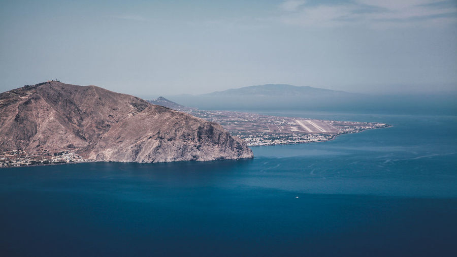 Blue Calm Coastline Greece Holiday Idyllic Island Mountain Mountain Range No People A Bird's Eye View Outdoors Remote Santorini Scenics Sea Sky Summer Tranquil Scene Tranquility Vacation Water The Great Outdoors With Adobe The Great Outdoors - 2016 EyeEm Awards Airport Runway Perspectives On Nature