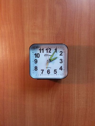 Clock on wood