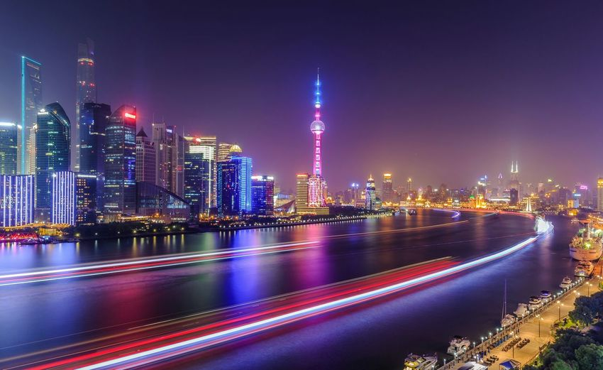 Light Trails On Huangpu River By Cityscape At Night