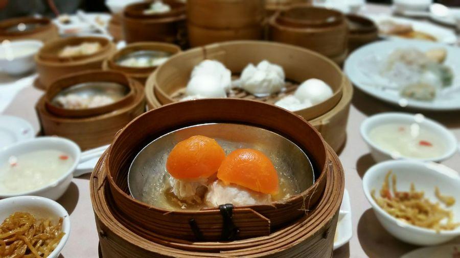 Close-up of fresh egg dim sum in container