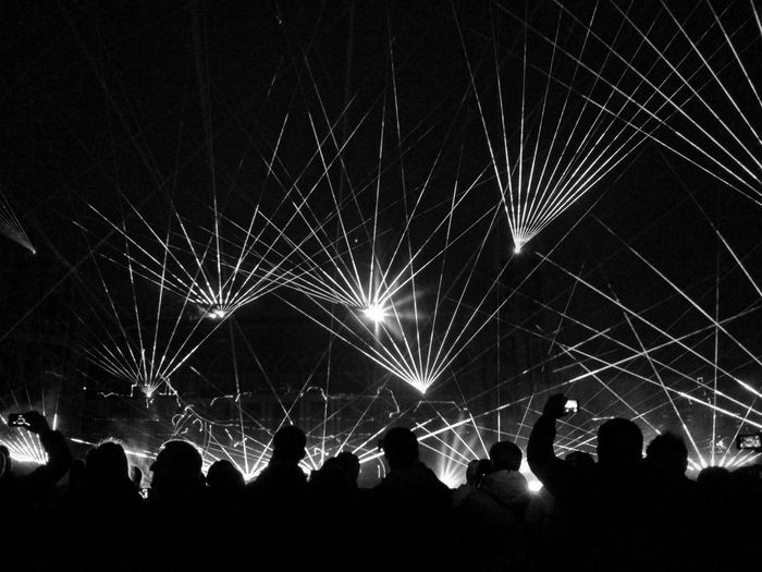 Silhouette People Watching Laser Show At Night