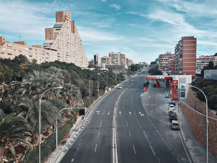 Panoramic view of road and cityscape against sky