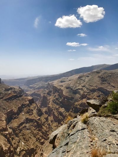 Canyon in Jabal Akhdar, Oman Explore Geological Crack Deep Steep Sky Cloud Mountain Canyon Middle East Jabal Akhdar Oman Sky Cloud - Sky Scenics - Nature Beauty In Nature Nature Mountain Environment Tranquility Landscape Tranquil Scene No People Mountain Range Sunlight Travel Outdoors