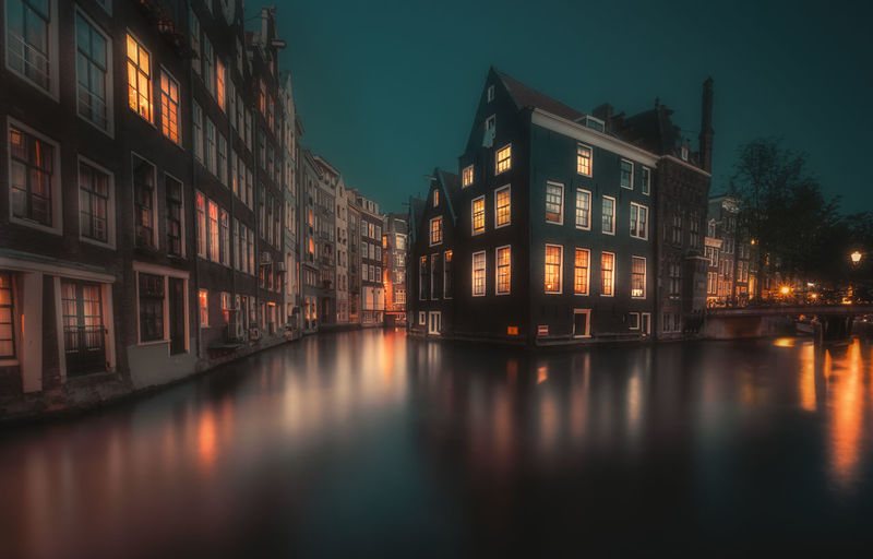 Amsterdam Remo SCarfo Holland Dutch EyeEm Best Shots EyeEmNewHere Building Exterior Architecture Illuminated Built Structure Building Night Reflection Water Waterfront Dusk City No People Residential District Nature Sky Canal Outdoors House Glowing Apartment Row House
