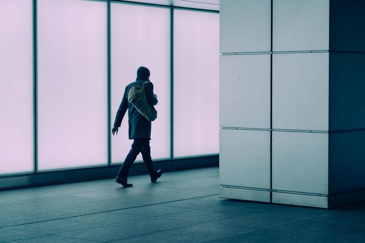 Full length of woman standing on floor
