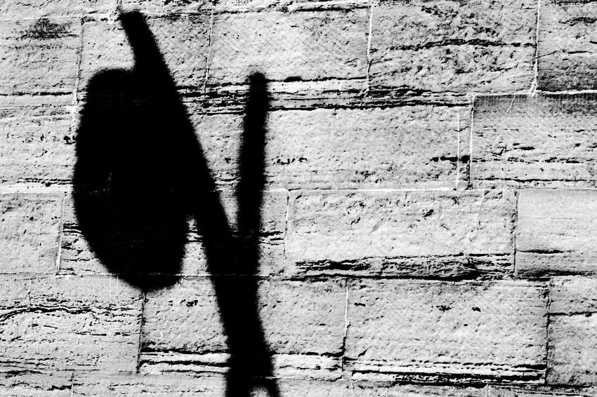 Light's Shadow Awful Pun Black & White Street Light Blackandwhite Day Focus On Shadow Light And Shadow Outdoors Shadow Stonework