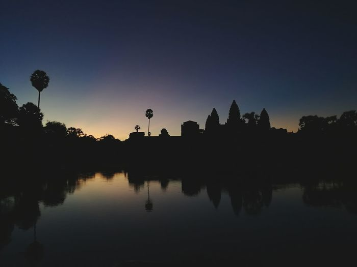 HuaweiP9 P9 Huawei PhonePhotography Sunrise Temple Angkor Wat Silhouette Architecture Palm Tree Lake Water Reflection Astronomy Water Tree Lake Reflection Sky Place Of Worship
