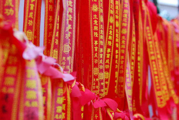 Close-up of clothes hanging on temple