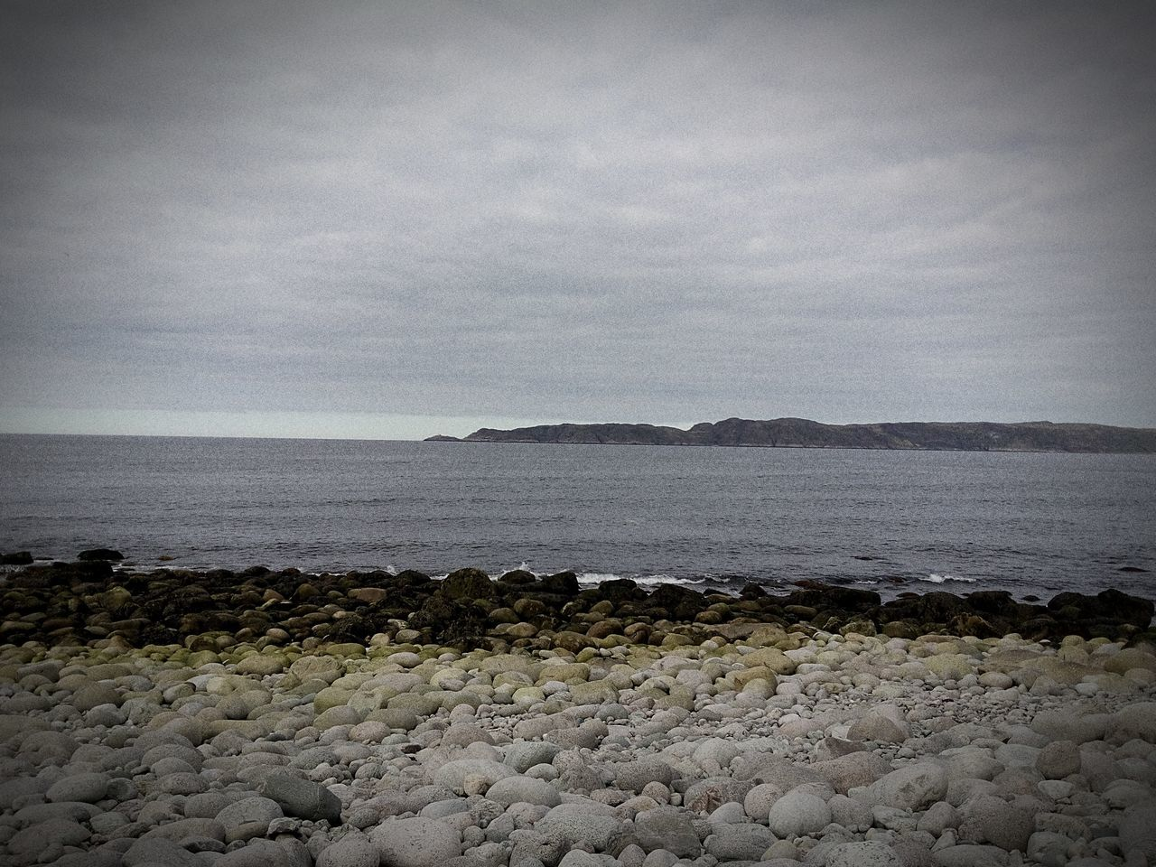 sea, water, nature, tranquility, sky, scenics, no people, pebble, tranquil scene, beauty in nature, beach, outdoors, pebble beach, horizon over water, day