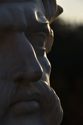 Close up antique male statue face with mustache in low sun side light Antique Art Close Up Close-up Closeup Closeupshot Copy Eye Face Imitation Male Man Marble Monument Mustache Nose Sculpture Side Light Sidelight Statue Stone Three Fours