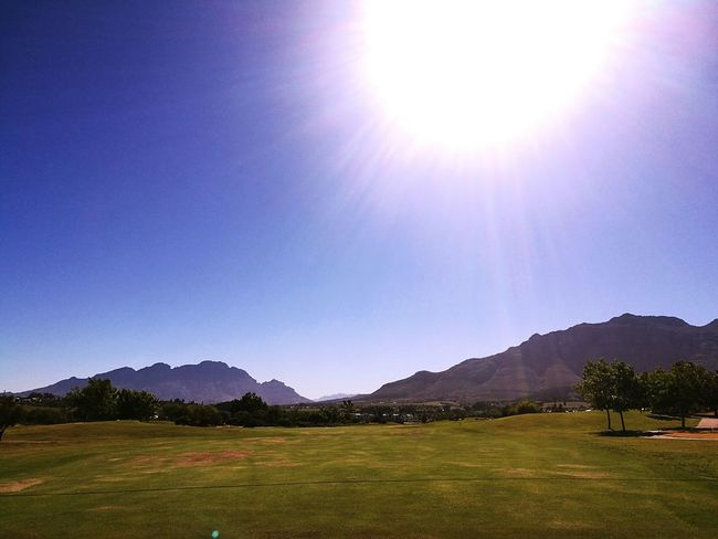 Colours And Patterns Golf ⛳ Mountain Mountain Range Sun Sunbeam Sunlight Clear Sky Blue Scenics Tranquil Scene Lens Flare Day Nature Beauty In Nature Bright Vacations Summer De Zalze Wine Farm Colors And Patterns
