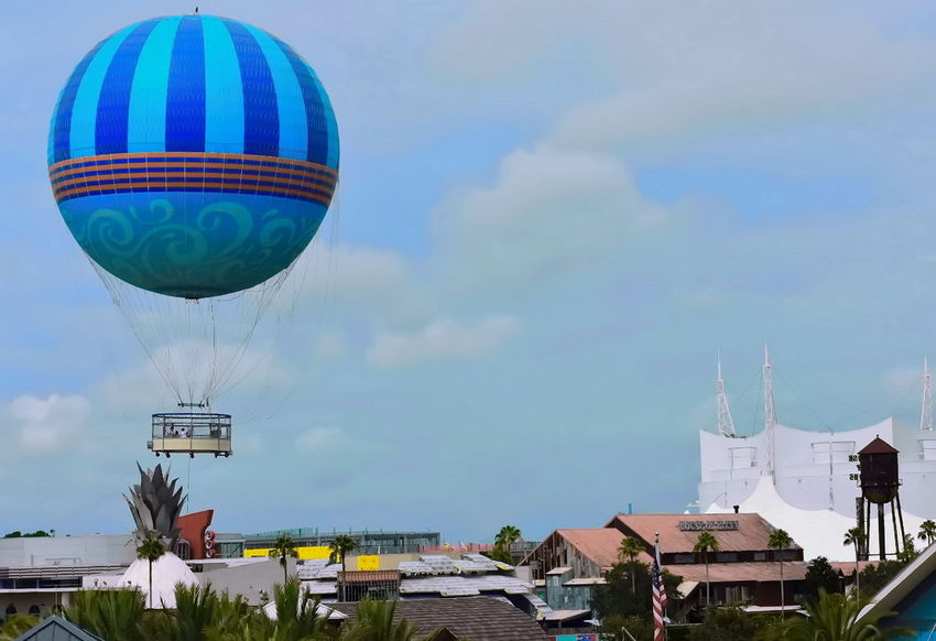 Orlando, Florida ; August 17, 2018 Colorful panoramic view, with flying air balloon in Lake Buena Vista 1 Walt Disney World DisneyWorld Disney Hotels Balloon Disney Store Taxi Boat Mickie Mouse Coca Cola Planet Hollywood Restaurant Art Decor Shopping Rollercoaster Disney Springs Attraction Theme Park Boardwalk Fireworks Summer Show Travel Tourism Italian Food Latin Food Magic
