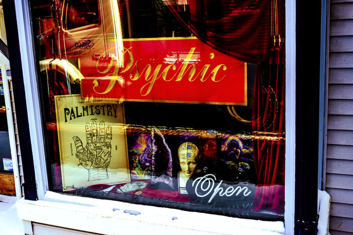 The Psychic Knows You're Here. Or does she? Business Future History Mind Reader Open Sign Palmistry Predict The Future Psychic Storefront Superstitious The Past Tommorrowland Window Display