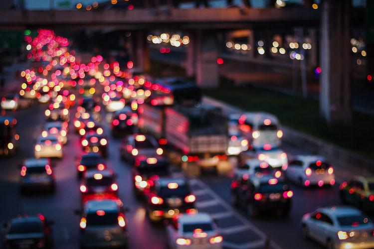 Defocused image of traffic on city street at night