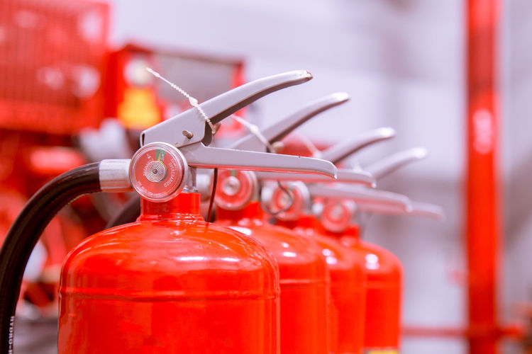 Close-up of red fire extinguishers
