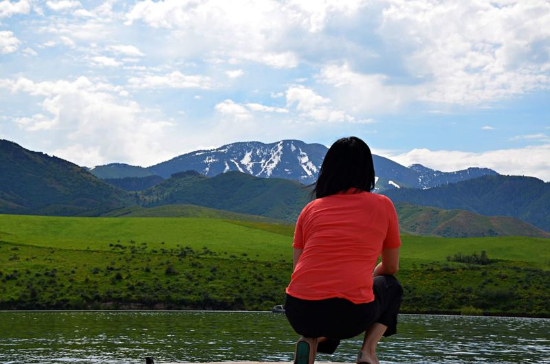 Clear Your Mind Idaho Looking Our Over A Lake Low Angle View Mountain Mountain Landscape Mountain Range One Person Person Crouching Down Real People Rear View Roadtrip Woman The Great Outdoors - 2017 EyeEm Awards Let's Go. Together. Breathing Space Done That.