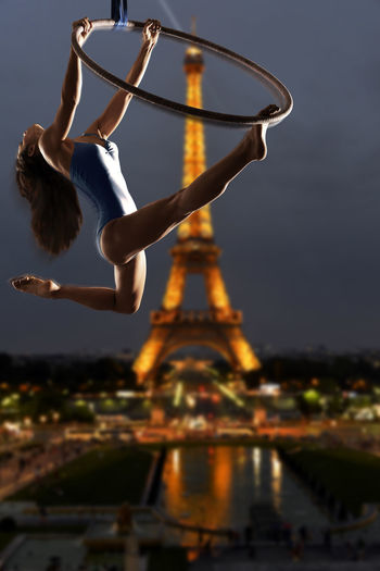 Woman Vertigo Paris, France  Paris ❤ Paris Paris, France  Outdoors Model Legs Beautiful Woman Aerial Hoop Aerial Acrobatics Aerial Acrobatics  Girl Paris, France  Acrobatic Acrobatics  Eiffel Tower Nightphotography Night Lights The Creative - 2018 EyeEm Awards