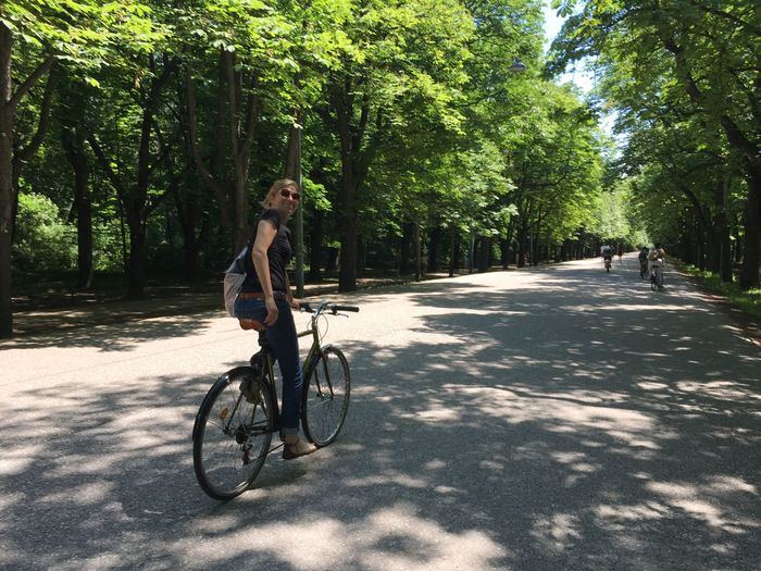 Tree Plant Bicycle Transportation One Person Sport Nature Full Length Young Adult Real People Activity Sunlight Cycling Ride Road Lifestyles Day Riding Leisure Activity Outdoors