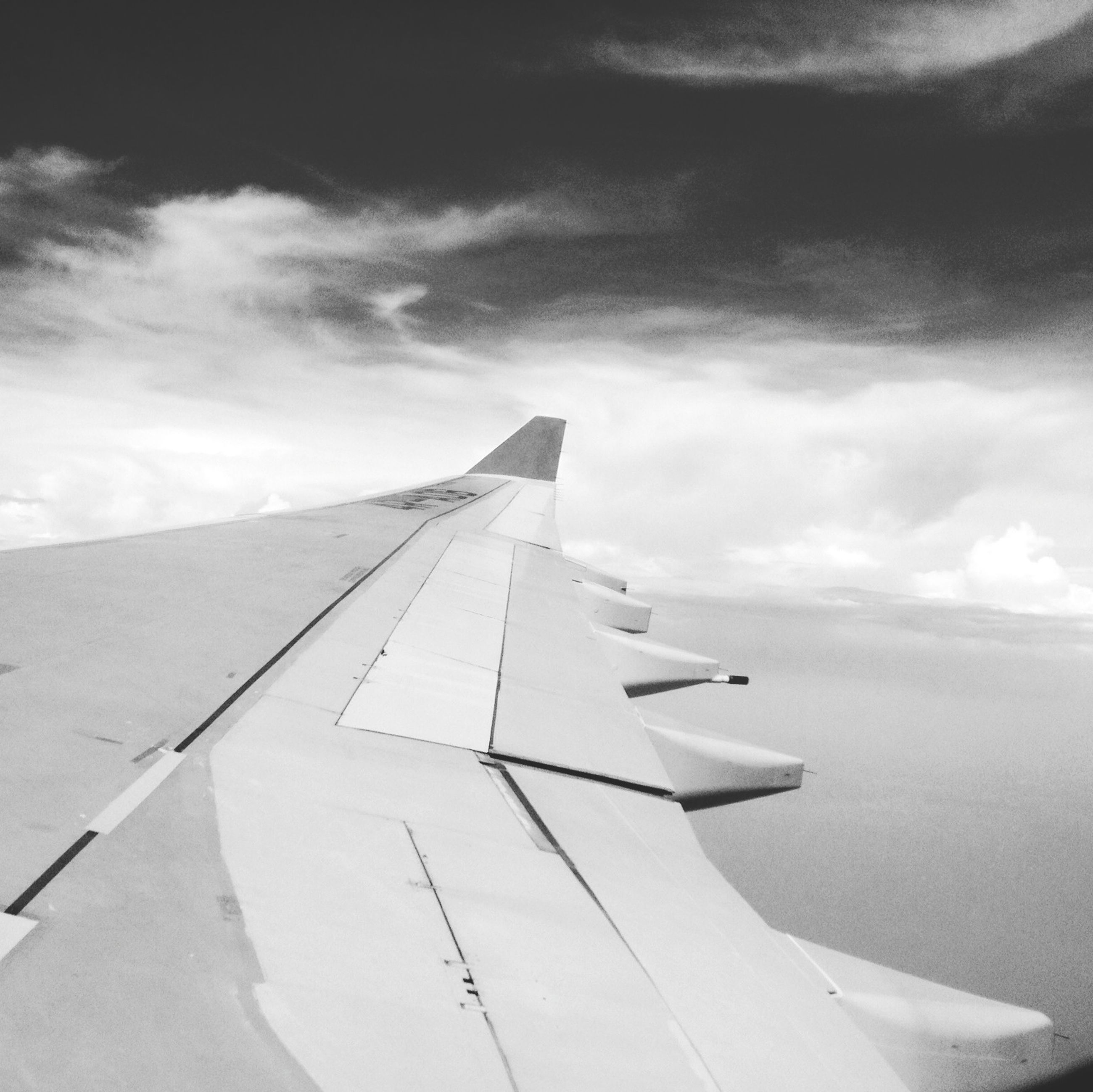 sky, airplane, air vehicle, flying, transportation, cloud - sky, aircraft wing, part of, cropped, cloud, low angle view, mode of transport, cloudy, mid-air, day, outdoors, travel, no people, nature, white color