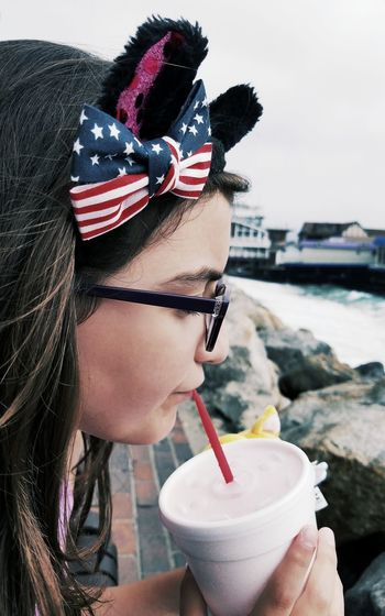 PATRIOTIC EARS... Accessory Ear Candid Kitty Ears Headband Kitty Ears Headband Flag 4th Of July Patriotism Headshot Side Portrait Drinking Little Girl Natural Light Portrait Hanging Out Children Photography Beach Outdoors Redondobeach Redondo Beach Pier Weekend Activities Summer Fashion