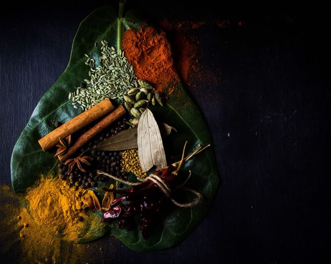 High angle view of spices on leaf