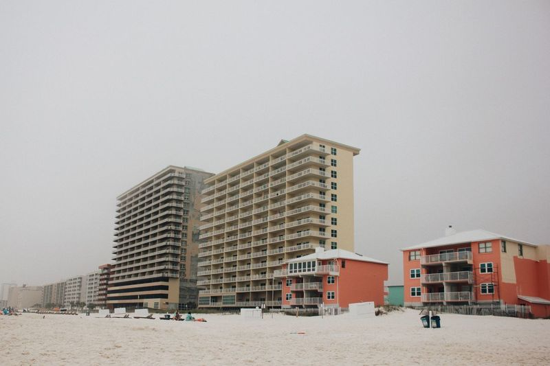 Cloudy beach EyeEm Selects Architecture Building Exterior Built Structure Building City Sky Nature Beach Apartment Outdoors Travel Destinations Land Sand Water