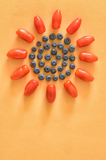 Plum tomatoes and blueberries on a sunny orange background Background Blueberries Blueberries Summer Healthy Food Fitspo Close-up Copy Space Day Food Food And Drink Freshness Fruit Healthy Eating Healthy Lifestyle Indoors  No People Plum Tomatoes Ready-to-eat Red Still Life Studio Shot Table Tomatoes Vegan Vegetable Vegetarian Vegetarian Food