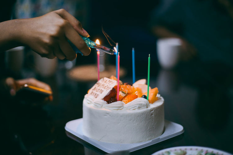 // fire it up // 50mm Birthday Cake Bokeh Cake Candle Candlelight Candles Celebration Close-up Colorful EyeEm EyeEm Best Shots Fruit Hand Hands Happy Lighter Shootermag Live For The Story Place Of Heart