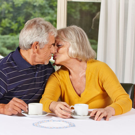 Man and woman sitting on table