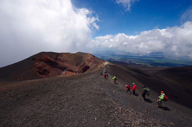 Scenic View Of People On Volcanic Landscape Against Sky
