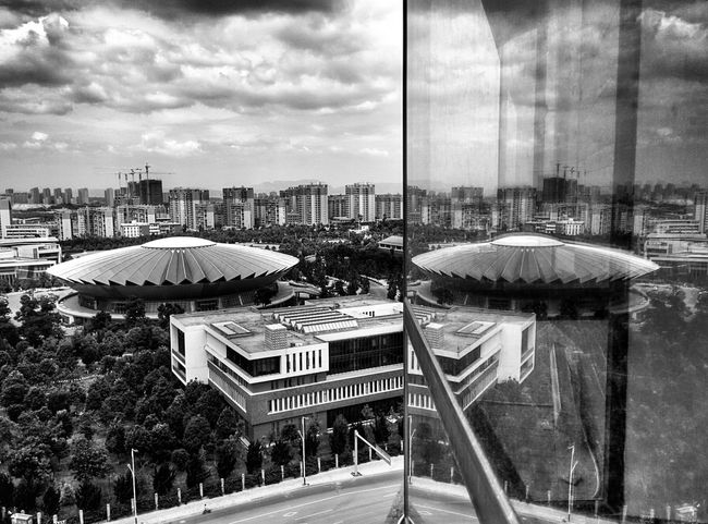 Yunnan Basketball court Reflected  in the window at the top of our hotel. China Architecture_bw Architecture Architecture_collection Architectureporn The Traveler - 2015 EyeEm Awards
