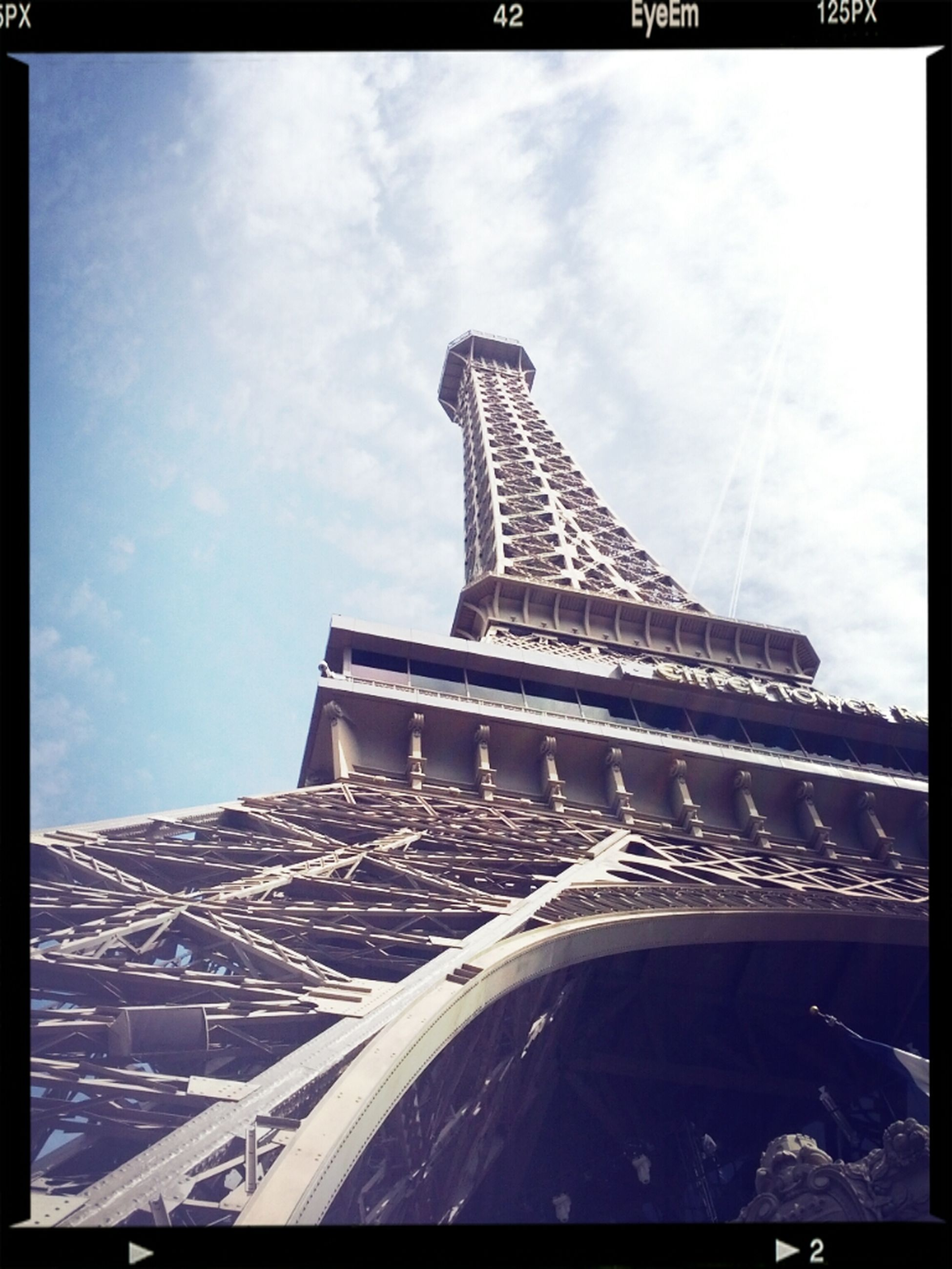 architecture, built structure, transfer print, building exterior, low angle view, sky, tower, auto post production filter, famous place, international landmark, tall - high, city, travel destinations, capital cities, architectural feature, cloud - sky, tourism, travel, eiffel tower, culture
