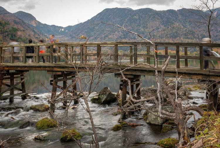 Mountain Water Mountain Range Architecture Bridge Built Structure Nature Connection Day Bridge - Man Made Structure No People Transportation River Scenics - Nature Tranquility Rock Beauty In Nature Outdoors Tranquil Scene