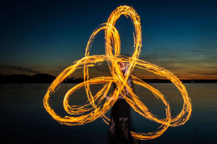 Playing With Fire Fire Dancer Flame Flame Photography Visual Creativity Dark Beauty Fire Fire Dancing Fire Performance Fire Performer Fire Photography Fire Portraits Fire Show Flames & Fire Lake Light Painting Long Exposure Motion Nature Night Outdoors Playing With Fire Sky Slow Shutter Portraits Slow Shutter Speed Water