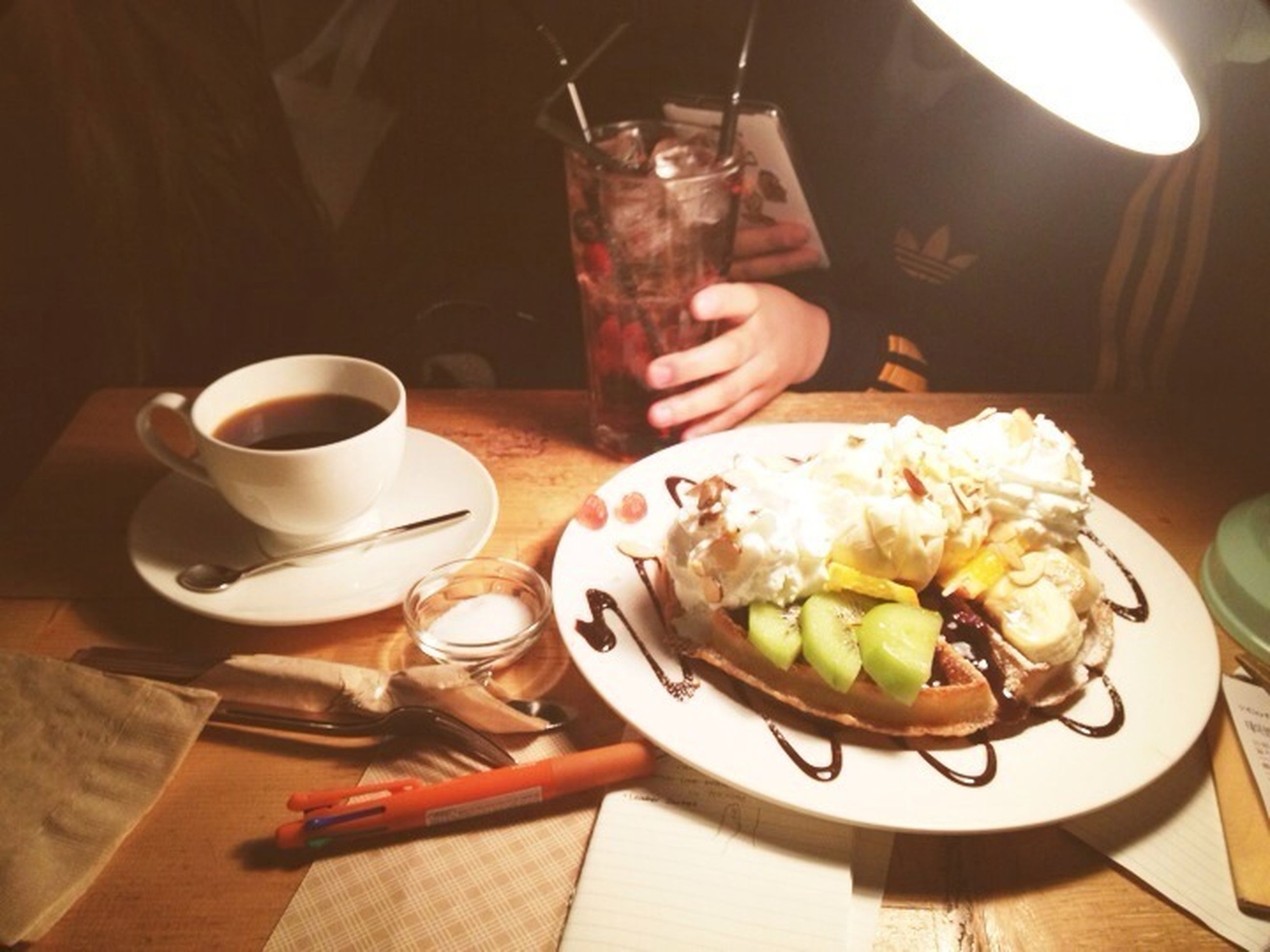 food and drink, table, indoors, drink, freshness, plate, food, refreshment, ready-to-eat, coffee cup, coffee - drink, still life, serving size, spoon, breakfast, healthy eating, meal, saucer, drinking glass, high angle view