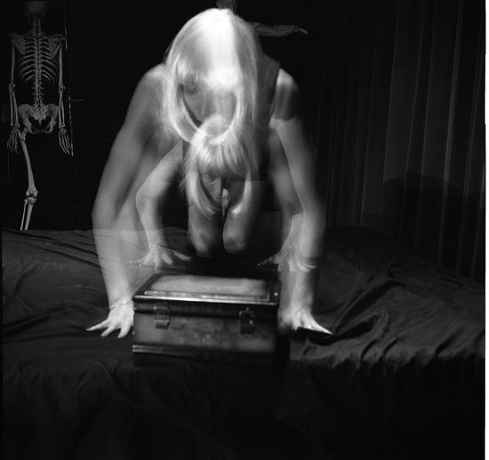 Double exposure of woman kneeling on bed with container at home