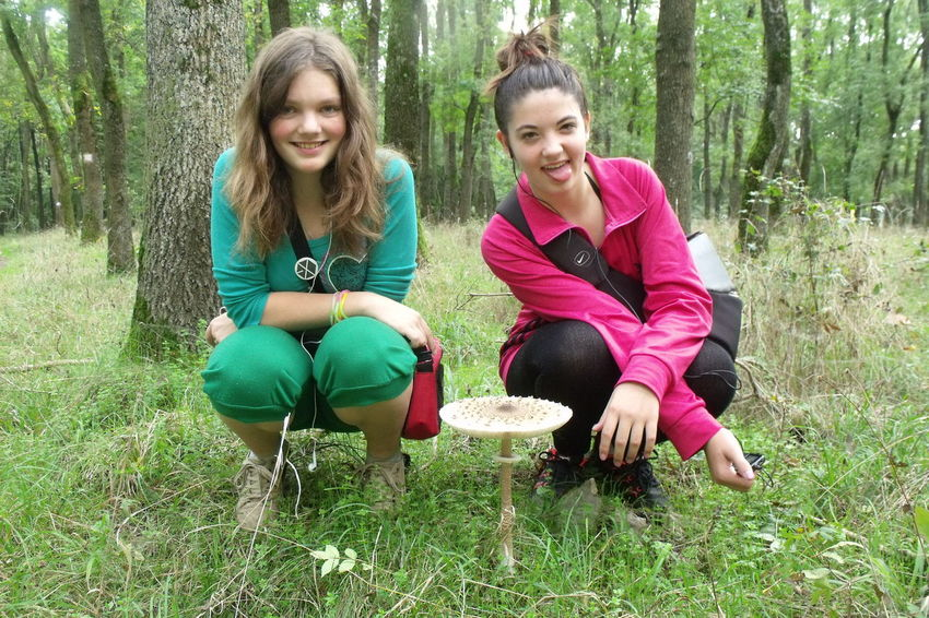 Mushroom&Dóri&Hédi Adult Bonding Casual Clothing Cheerful Day Forest Freshness Full Length Grass Happiness Leisure Activity Looking At Camera Nature Outdoors People Portrait Real People Sitting Smiling Togetherness Tree Tree Trunk Two People Young Adult Young Women