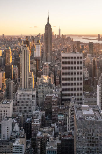 View of New York Skyline from the Rockefeller Centre. Cityscape Built Structure Skyscraper Modern Outdoors Architecture Office Building Exterior Skyline New York NYC Sunset Rockefeller Center Empire State Building Top Of The Rock City Building Exterior Building