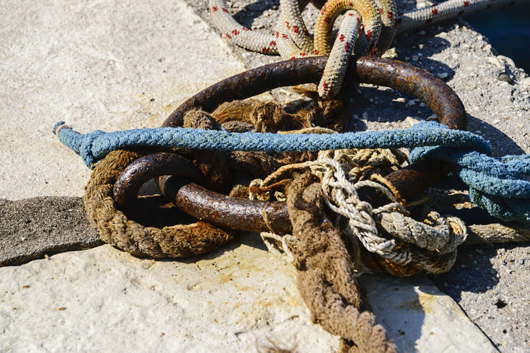 High angle view of ropes tied on hook