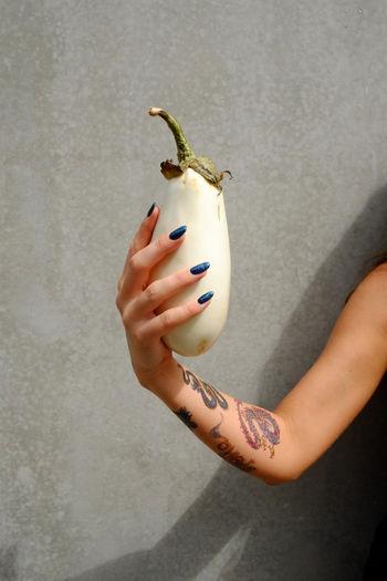 Cropped Hand Holding Eggplant