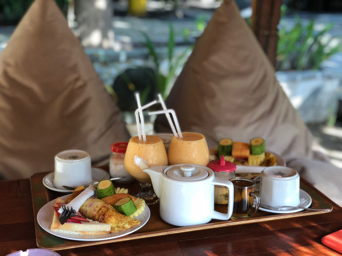 INDONESIA Bread Breakfast Business Crockery Cup Drink Food Food And Drink Freshness Healthy Eating Hot Drink Household Equipment Indonesia Photography  Indonesia Photography  Meal Mug One Person Plate Ready-to-eat Real People Refreshment Restaurant Table Wellbeing