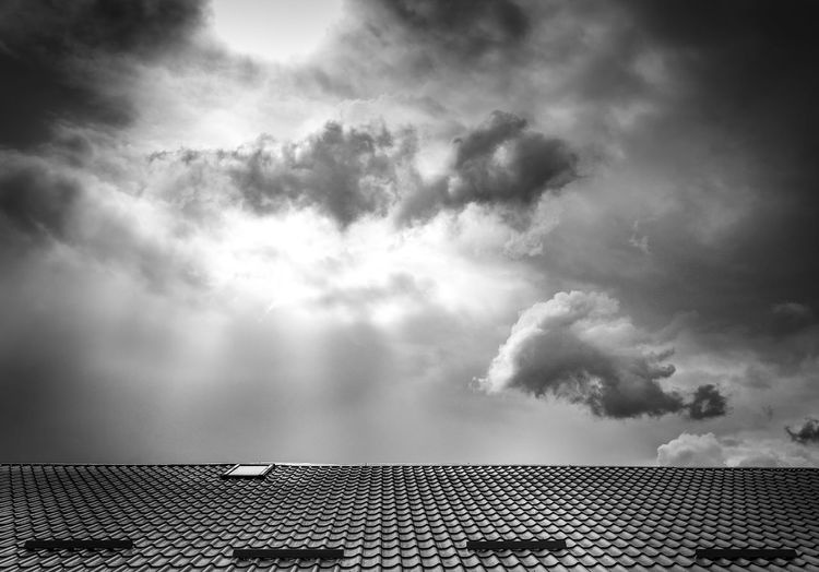 Architecture Beauty In Nature Black & White Black And White Black And White Photography Blackandwhite Blackandwhite Photography Building Exterior Built Structure Cloud - Sky Day Low Angle View Nature No People Outdoors Ray Of Light Rays Roof Sky Sky And Clouds Skyline Spot Storm Cloud Sun Tiled Roof