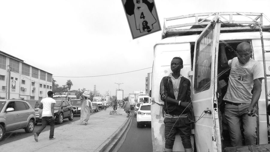City Life Day Real People Occupation People Blackandwhite Streetphotography Street Photography Black And White Bw_collection Streetphoto_bw Eye4blackandwhite Eye4photography Light And Shadows Boy Senegal