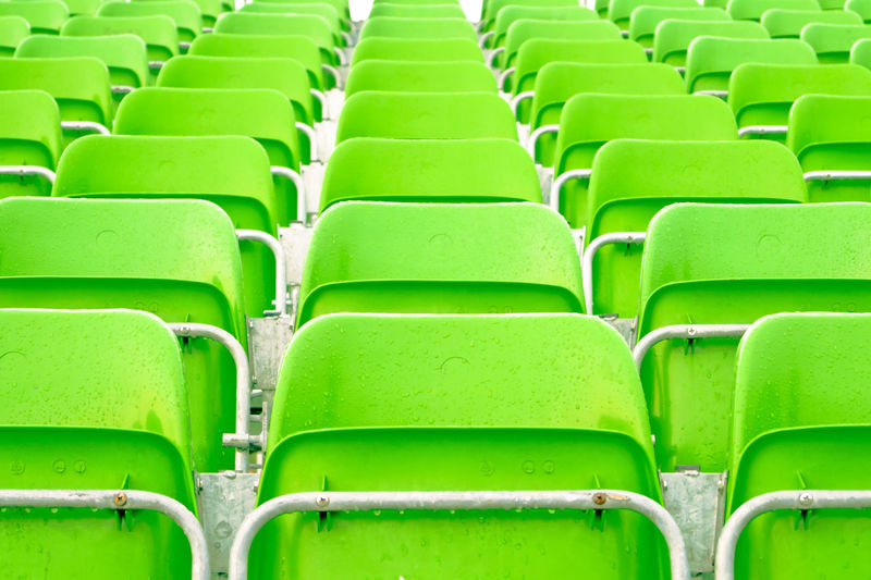 Postcode Postcards Rethink Things Stadium Stadium Seating Abundance Backgrounds Chair Conformity Day Empty Folding Chair Full Frame Green Color In A Row Indoors  No People Repetition Seat Seats