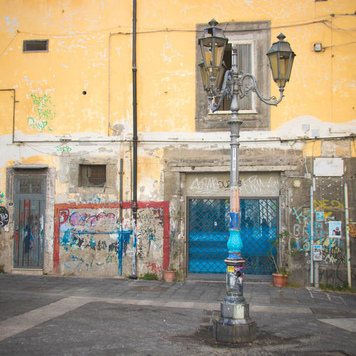 Naples Italy❤️ South Italy City Street Streetphotography Architecture Building Exterior Day Outdoors Footpath Paved Built Structure Lighting Equipment Wall - Building Feature Building No People Yellow Street Light Old Sidewalk Wall Electric Lamp Lantern Technology